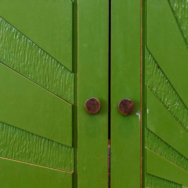 detail of handles and carving on green unit doors