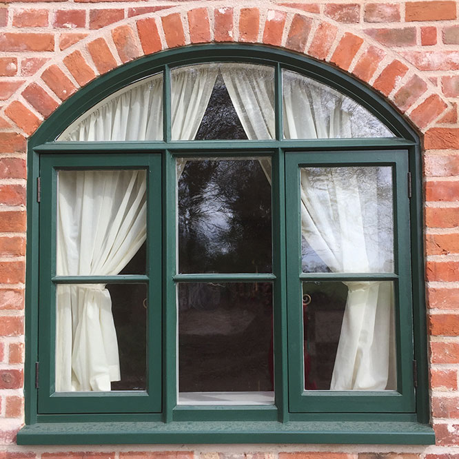 view of a green window with arch at the barn house