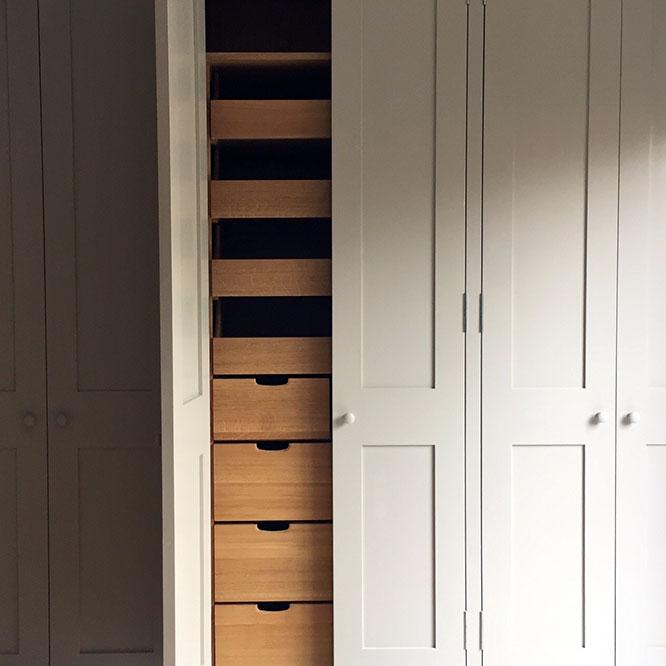 inbuilt cupboards with open doors